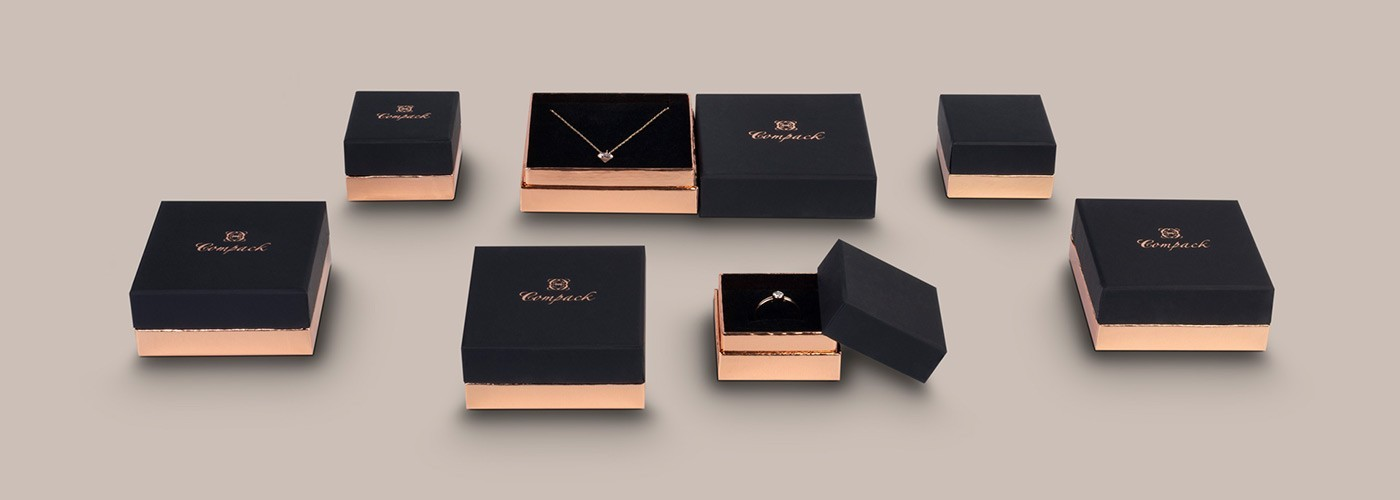 Cardboard boxes for jewelry, in black and pink gold